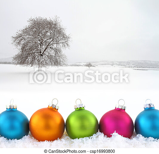 Colorful Christmas balls with snowfield as background - csp16993800