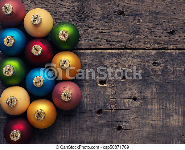 Colorful Christmas baubles on wood - csp50871769