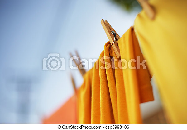 Colorful clothes drying on clothesline - csp5998106