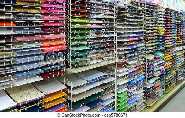 Colorful craft or scrapbook paper on shelves - csp5780671