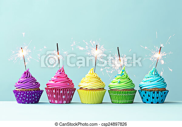 Colorful cupcakes with sparklers - csp24897826