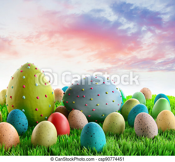Colorful decorated eggs in the grass - csp90774451