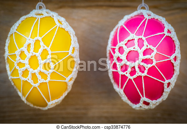 Colorful Easter eggs on wooden background - csp33874776
