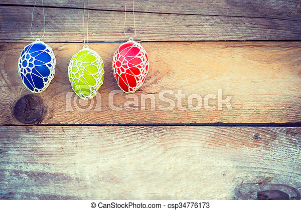 Colorful Easter eggs on wooden background - csp34776173