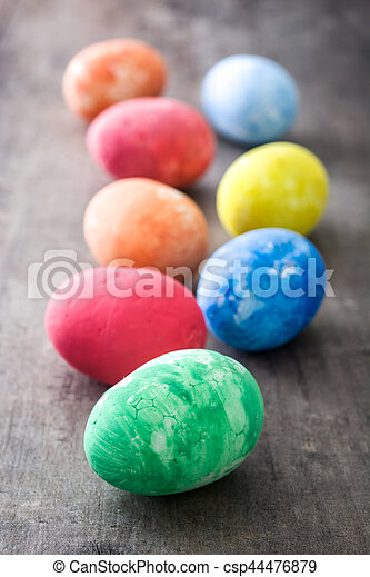 Colorful Easter eggs on wooden background - csp44476879