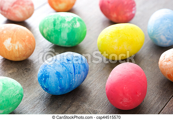 Colorful Easter eggs on wooden background - csp44515570
