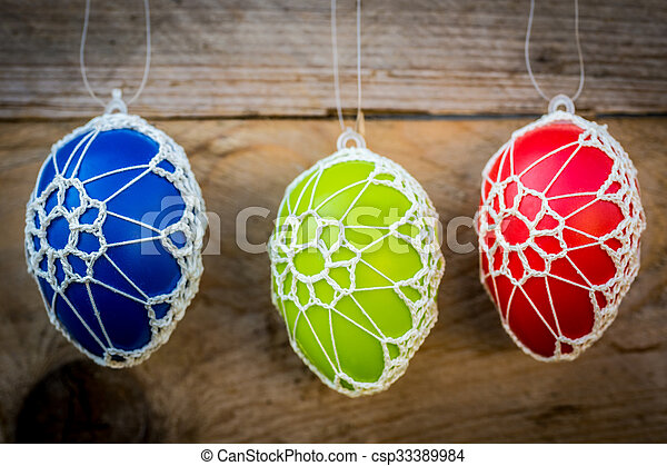 Colorful Easter eggs on wooden background - csp33389984
