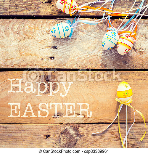 Colorful Easter eggs on wooden background - csp33389961