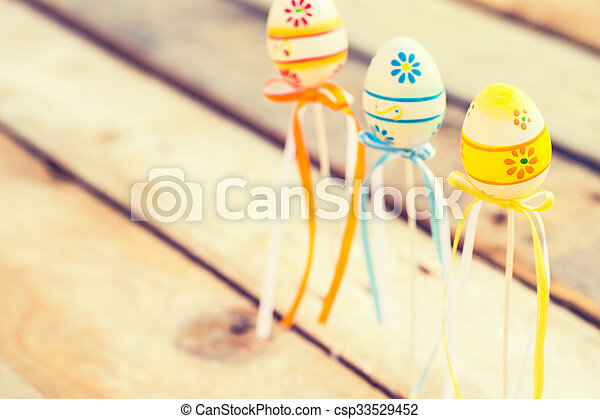 Colorful Easter eggs on wooden background - csp33529452