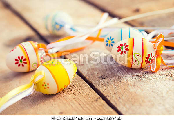 Colorful Easter eggs on wooden background - csp33529458