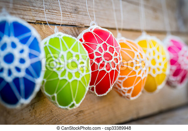 Colorful Easter eggs on wooden background - csp33389948