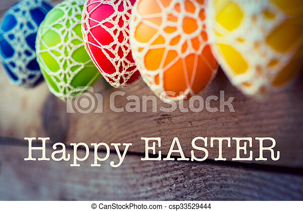 Colorful Easter eggs on wooden background - csp33529444