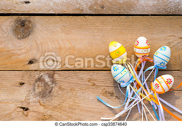 Colorful Easter eggs on wooden background - csp33874640
