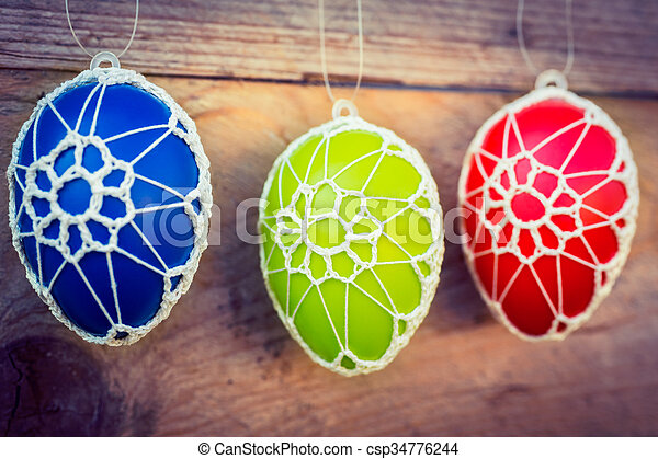 Colorful Easter eggs on wooden background - csp34776244