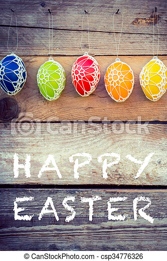 Colorful Easter eggs on wooden background - csp34776326
