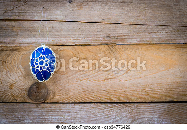 Colorful Easter eggs on wooden background - csp34776429