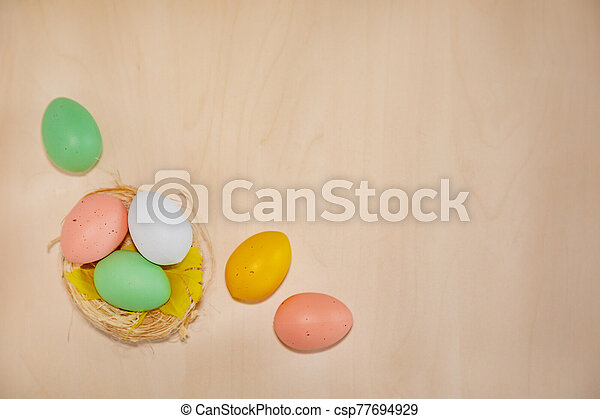 Colorful easter eggs on wooden background - csp77694929