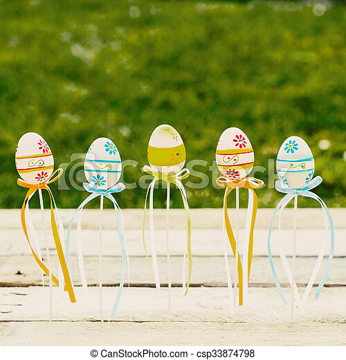 Colorful Easter eggs on wooden background - csp33874798
