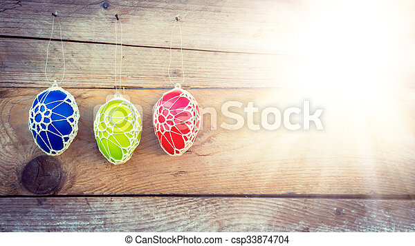 Colorful Easter eggs on wooden background - csp33874704