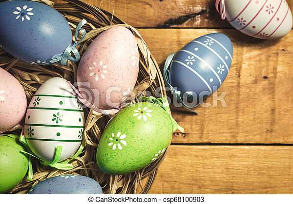 Colorful Easter eggs on wooden background - csp68100903