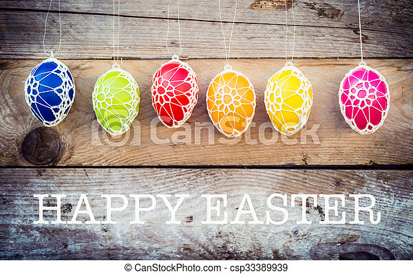 Colorful Easter eggs on wooden background - csp33389939