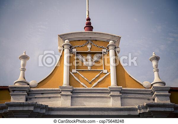 colorful facade of a building in Peru - csp75648248