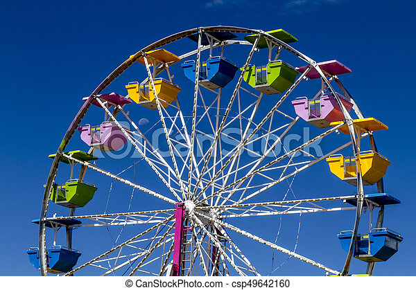Colorful ferris wheel at local carnival. Ferris wheel with ...
