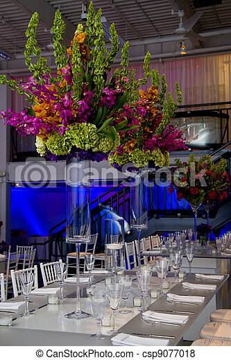 Colorful flower arrangement and table - csp9077018