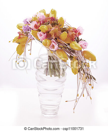Colorful flower arrangement in glass vase with yellow tulips - csp11001731
