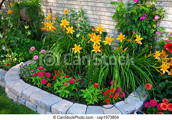 Colorful Flower Bed A Stone Edged Urban Flower Bed That Packs A