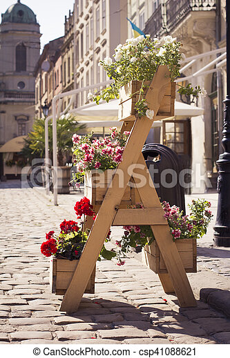 Colorful flower stand in the city - csp41088621