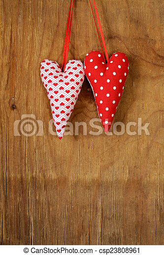 colorful handmade fabric hearts - csp23808961