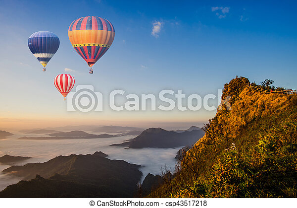Colorful hot-air balloons flying over the mountain - csp43517218