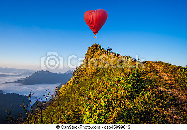 Colorful hot-air balloons flying over the mountain - csp45999613