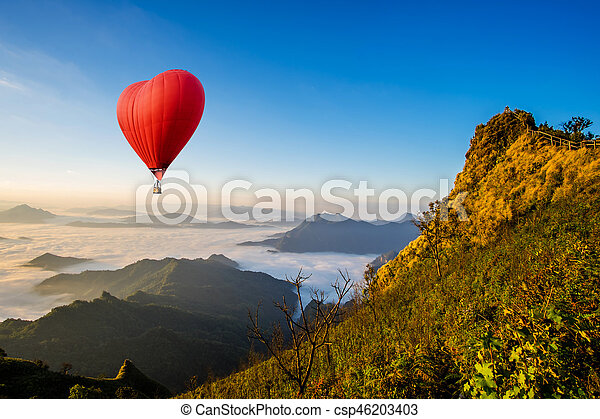 Colorful hot-air balloons flying over the mountain - csp46203403