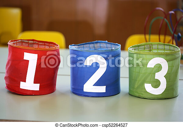 colorful jars with drawn numbers 1 2 3 on the school table - csp52264527