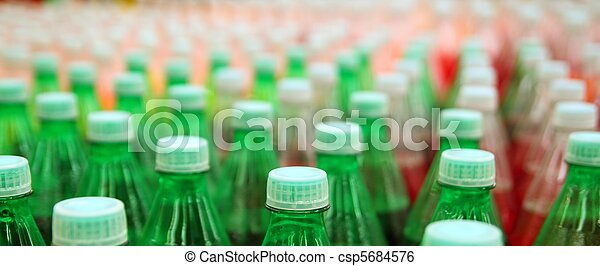 colorful juice beverage plastic bottle in factory - csp5684576