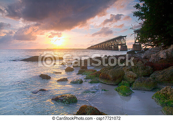 Colorful landscape of a beautiful tropical sunset or sunrise. Taken at Bahia Honda Key State Park in Florida. Old Flagler Bridge remains as a tourist landmark and a monument to a hurricane.  - csp17721072