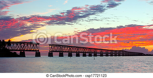 Colorful landscape of a beautiful tropical sunset or sunrise. Taken at Bahia Honda Key State Park in Florida. Old Flagler Bridge remains as a tourist landmark and a monument to a hurricane.  - csp17721123