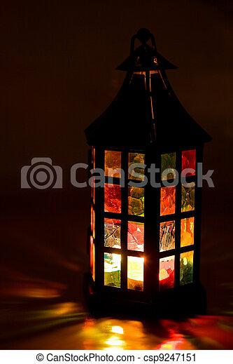 colorful lantern burning in the dark - csp9247151