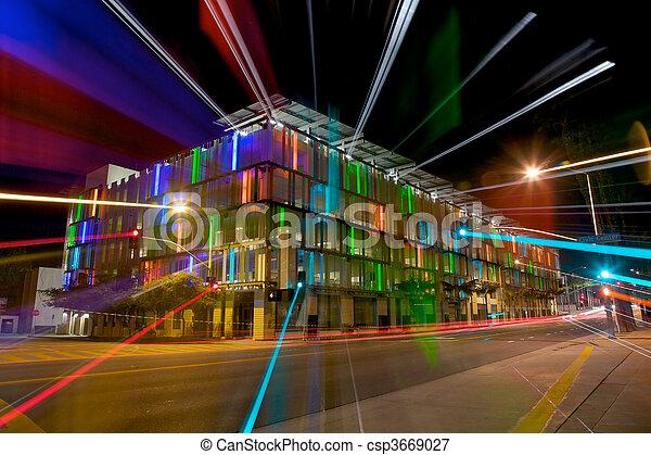 Colorful Lit Parking Garage at Night - csp3669027