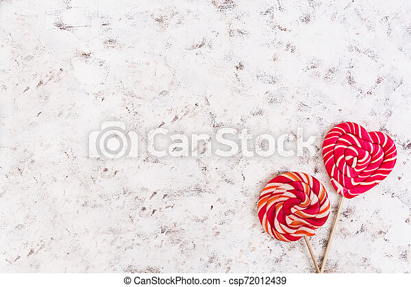 Colorful lollipops on white background. Top view - csp72012439