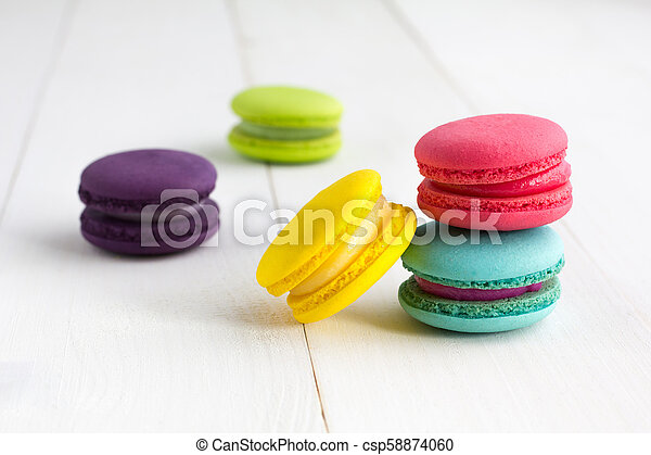 Colorful Macaroons on white wooden background. - csp58874060