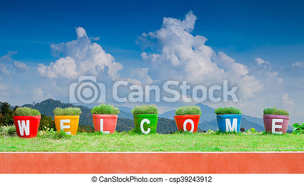 Colorful of the Welcome on blue sky background - csp39243912