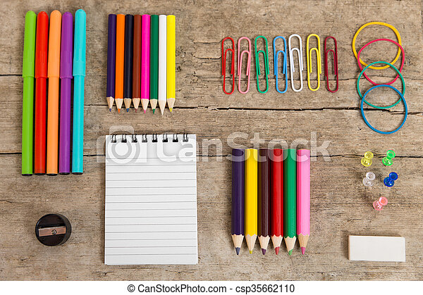 Colorful Office Desk With A Notepad, Pencins And Other Equipment    Csp35662110