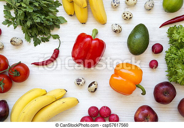 Colorful pattern of health food on a white wooden table. Healthy eating. Top view. From above. - csp57617560