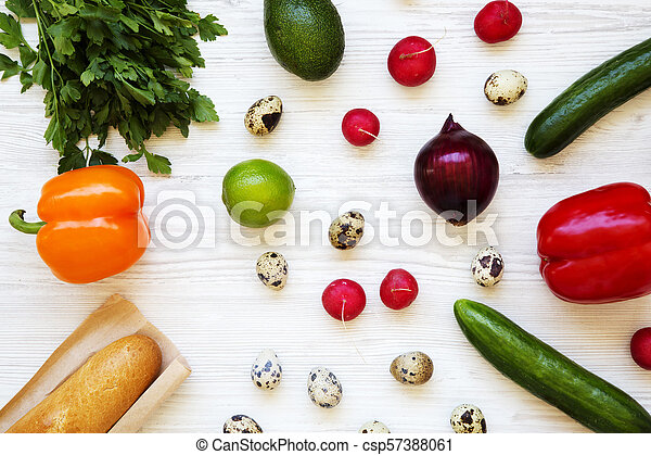 Colorful pattern of healthy food on a white wooden background. Top view. From above. - csp57388061