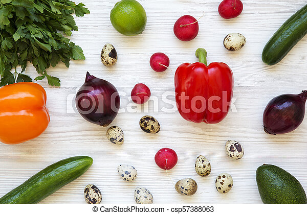 Colorful pattern of healthy food on a white wooden background. Top view. From above. - csp57388063