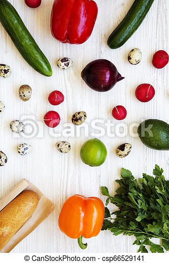 Colorful pattern of healthy food on a white wooden table, top view. From above, overhead. - csp66529141