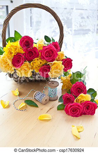 Colorful roses in a vintage basket - csp17630924